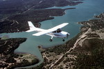A Cessna 172 from Kelly Flight Training Center flies over Medina Lake, near San Antonio in the US. (DoD)