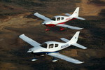 Two Cessna 350 light aircraft in flight. The aircraft was known as the Columbia 350 when built by that company. (Cessna)