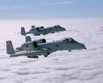 Two A-10Cs of the Maryland Air National Guard's 104th Fighter Squadron train over Maryland's Eastern Shore on 14 June 2007 (USAF/Senior Master Sgt Jim Foard)
