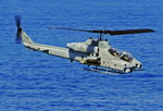 A US Marine Corps Bell AH-1W Super Cobra over the ocean on 9 June 2009. (USN/Mass Communication Specialist 2nd Class Kristopher Wilson)