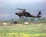 A US Army Apache during Operation Allied Force in 1999. In the background is a US Army TOW Missile Launcher. (DoD)