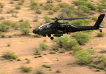 A Royal Netherlands Air Force AH-64D Apache flying over the Arizona countryside takes part in Exercise Angerl Thunder 2010 on 16 April 2010. (USAF/Staff Sgt Jjoshua L DeMotts)