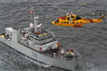 An AgustaWestland CH-149 Cormorant from 442 Squadron hovers over the HMCS Brandon Maritime Coastal Defence Vessel during training near British Columbia on 28 January 2003. (Canadian Forces photo by Corporal Joseph Morin)