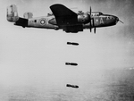 A North American B-25 Mitchell of the RAF releasing a stick of bombs. (RAF(