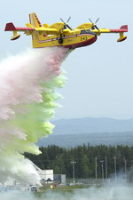 A Bombardier CL-415 demonstrates its water-dropping capability at the Bagotville International Air Show June 2007 in Quebec. (CF Photo by Cpl Julie Belisle)