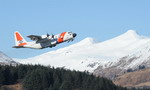 A US Coast Guard HC-130 Hercules from Coast Guard Air Station Kodiak, Alaska, takes off for a training mission on 25 February 2010. (USCG/Petty Officer 3rd Class Jonathan Lally)