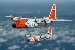 A C-130H and HC-130J on 17 September 2009, painted to celebrate 50 years of the C-130 in US Coast Guard Service. (USCG/Dave Silva)