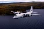 A Minessota Air National Guard C-130H3 from the 133rd Airlift Wing flies past Split Rock Lighthouse on Lake Superior, MN, on 2 October 2002. (USAF/MSgt Ray Kennedy)