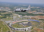A Lockheed C-130H2 Hercules from the 440th Airlift Wing, Pope AFB, NC, flies over Lowe's Motor Speedway. (DoD)