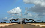 A C-17 Globemaster III from the 452nd Air Mobility Wing at March Air Reserve Base, Calif, taxis on the runway at Ramey Field, Puerto Rico, during Exercise Patriot Hoover on May 2, 2009. The exercise is a large-scale air mobility exercise involving units with Air Force Reserve Command, Puerto Rico's Air National Guard, and units from the FBI. (USAF/Master Sgt Rick Sforza)