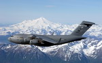 "The ""Spirit of Denali"" flies over the Alaska Range en route to Elmendorf Air Force Base, Alaska. This C-17 Globemaster IIIs was the first of eight to be stationed at Elmendorf. (USAF/Tech Sgt Keith Brown)"