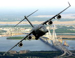 A Boeing C-17 Globemaster III from the 315th Airlift Wing, Charelston AFB, flies past the Arthur J Ravenel Bridge on 16 May 2006. (USAF/TSgt Russell E Cooley IV).