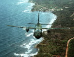 A C-27 Spartan, from the 310th Airlift Squadron, flies over the Panamanian coastline. (DoD)