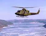 A CH-146 Griffon over the Saguenay river in Canada on 21 November 2006. (CF Photo)