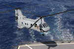 A CH-46 Sea Knight from Marine Medium Helicopter Squadron 166,  approaches the deck of the USS Pecos during a Visit Board Search and Seizure exercise on 3 March 2006. (USMC)
