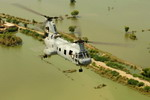 A US Marine Corps CH-46 Sea Knight from the 15th Marine Expeditionary Unit flies over Pakistan during flood relief efforts on 5 September 2010. (USAF/Staff Sgt Andy M Kin 2)