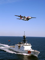 A US Coast Guard HC-144A Ocean Sentry flies over the cutter Bertholf on 11 February 2008, with an MH-65C Dolphin in tow. (USCG/PA2 Thomas Blue)