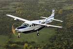 A Cessna Grand Caravan flying with a cargo pannier. (Cessna)