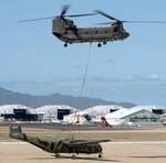 An Australian Army Aviation CH-47 Chinook prepares to lift a RAAF DHC-4 Caribou. (Australian DoD)
