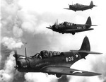 Douglas TBD-1 Devastators from Navigation Operational Training Command, Naval Air Station Miami, fly over southern Florida.