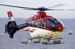 A Eurocopter EC 135 fitted with flotation bags for overwater flight. (Eurocopter)