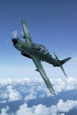An Embraer EMB-314 Super Tucano in flight. The Super Tucano was developed from the earlier Tucano, but is a completely different aircraft. (Embraer)