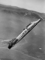 A North American F-100A Super Sabre at a 45-degree climb. (USAF)