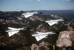 Four F-106s from the USAF's 5th Fighter Interceptor Squadron above Mount Rushmore on 27 July 1981. (USAF/SSGt Bill Thompson)