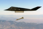 A Lockheed F-117 Nighthawk dropping a GBU-28 guided bomb unit during live-fire weapons testing mission Combat Hammer, at Hill Air Force Base, Utah. (USAF/MSGT Edward Snyder)