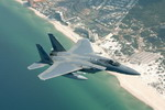 A Boeing (McDonnell Douglas)  F-15 Eagle flies over Panama City, Florida, as it approach Tyndall AFB.  (USAF)