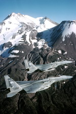 Two F-15 Eagles from the 114th Fighter Squadron, 173rd Fighter Wing, fly past Mount Shasta in 1999. (USAF/MSgt Dave Nolan)