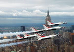 The Thunderbirds aerobatic team fly over past the Empire State Building, New York. (USAF/TSgt Sean Mateo White)