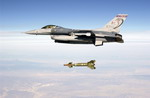 An F-16C Fighting Falcon from the US Air Force's 160th Fighter Squadron, Alabama ANG, drops a GBU-24A laser guided bomb during exercise Combat Hammer on 30 July 2002. (USAF/TSgt Michael Ammons)
