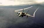 A US Navy F/A-18 Hornet from Strike Fighter Squadron 94 of the USS Nimitz flies over the Pacific Ocean on 25 October 2003. (USN/Photographer's Mate 3rd Class Elizabeth Thompson)