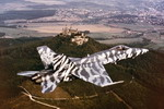 A Boeing CF-18 Hornet from the Canadian air force's 439 Tiger Squadron flies over the Hohenzollern castle near Baden-Wuerttemberg, Germany, on 1 October 1992. (CF Photo)