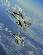 Two US Marine Corps Hornets from VMFA-323, Marine Corps Air Station Miramar, Cali, over the Pacific on 12 July 2010 during exercise Rim of the Pacific (USAF/TSgt Jacob N Bailey)