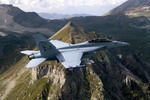 A Boeing F/A-18 Hornet in flight over mountains (Boeing)