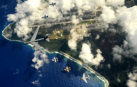 A US Air Force B-52 leads two F-16s and a US Navy EA-6B on its left wing and to Japan Air Self Defence Force F-2s on its right wing over Guam on 10 February 2009 during Exercise Cope North 09-1. (USAF/ Master Sergeant Kevin J Gruenwald)