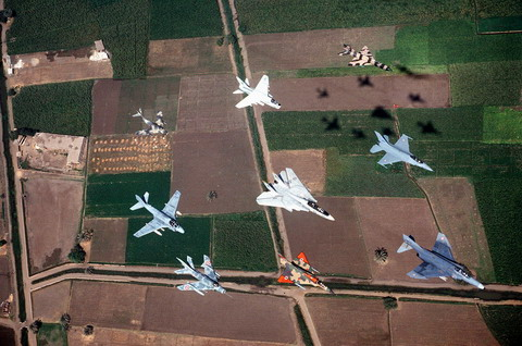 A formation of US and Egyptian aircraft, including (from left to right) a MiG-15, MiG-19, A-7, F-14, Mirage III, MiG-21, F-16 and F-4. (DoD)