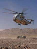 A US Marine Corps CH-53E Super Stallion lifting a Humvee at Marine Corps Air Station Yuma on 14 June 2006 as part of Operation Desert Talon. (USMC/Sgt Guadalupe M Deanda III)