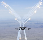 An AV-8B Harrier from Marine Attack Training Squadron 203 (VMAT-203), Marine Corps Air Station Cherry Point, fies flares during a training flight on 27 July 2010. (USMC/Cpl Graham J Benson)