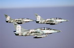 Three Royal Thai Air Force L-39s during a combat training exercise during Exercise COPE TIGER 2003. (DoD)