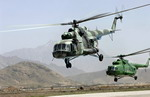 Two Afghan National Air Corps Mi-17 Hip H helicopters take off from Kabul on 2 April 2007 to practice for Afghan National Day. (USAF/Tech Sgt Cecilio M Ricardo Jr)