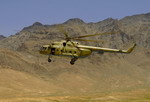 An Afghan National Air corps Mi-17 hovers over a firing range near Kabul International Airport on 11 May 2008. (USAF/Master Sgt Andy Dunaway)