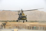 A Mil Mi-17 flies out of Kandahar, Afghanistan, on 25 June 2008. (JTF/MCpl Karl Mckay)