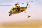 Two Afghan Mi-35s in flight.