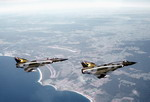 Two Royal Australian Air Force Dassault Mirage IIIs in flight. (DoD)