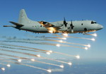 A Lockheed AP-3C Orion from the Royal Australian Air Force's 92 Wing releases flares as part of a trial to test its self protection systems on 2 August 2005. (RAAF)