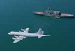 A Royal Australian Air Force AP-3C Orion from 92 Wing over HMAS Manoora on 5 August 2005. (RAAF)