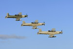 Pilatus PC-9s from the Royal Australian Air Force's No 4 Squadron return to RAAF Base Townsville on 24 June 2010. (Australian MoD)